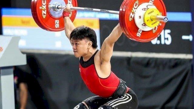 Rahmat Erwin Abdullah, salah satu atlet cabang olahraga angkat besi Indonesia asal Sulawesi Selatan yang tampil di Olimpiade Tokyo 2020.